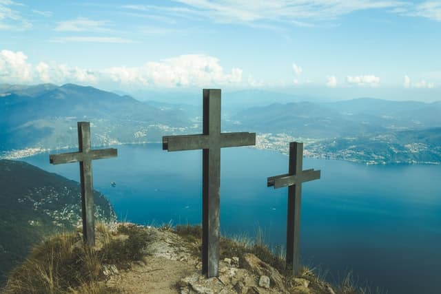 Three Crosses on a mountaintop, overlooking a bay